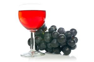 Red wine in glass with grape